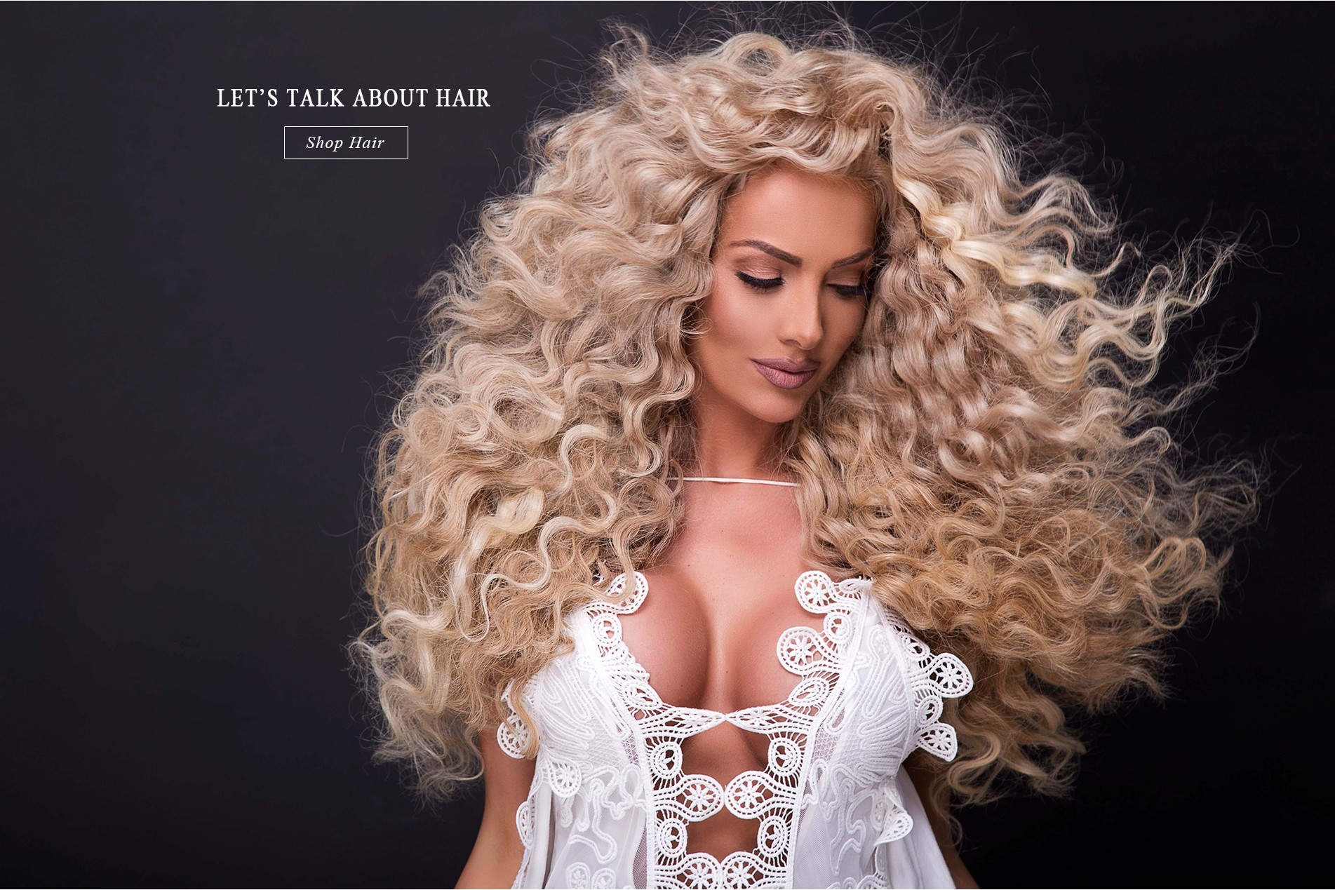 Very curly blond woman with hair extensions